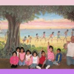 Mural painted for the Purple Palace for the kids rescued off the streets in Tijuana, Mexico. Most of these kids come from dangerous streets and abandoned by family. Children being led along the beach by Pegasus and holding onto a purple ribbon. I painted 16 different animals for them to find including two monkeys, snake, gecko, woodpecker, frog, armadillo, mouse, dolphins, whale, seagull & more.