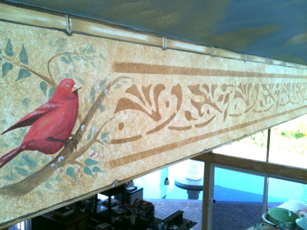 Red bird and stencil closeup by Rik Erickson in San Diego, California mural