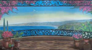 Mural looking at La Jolla Cove from a balcony with black iron railings and potted plants