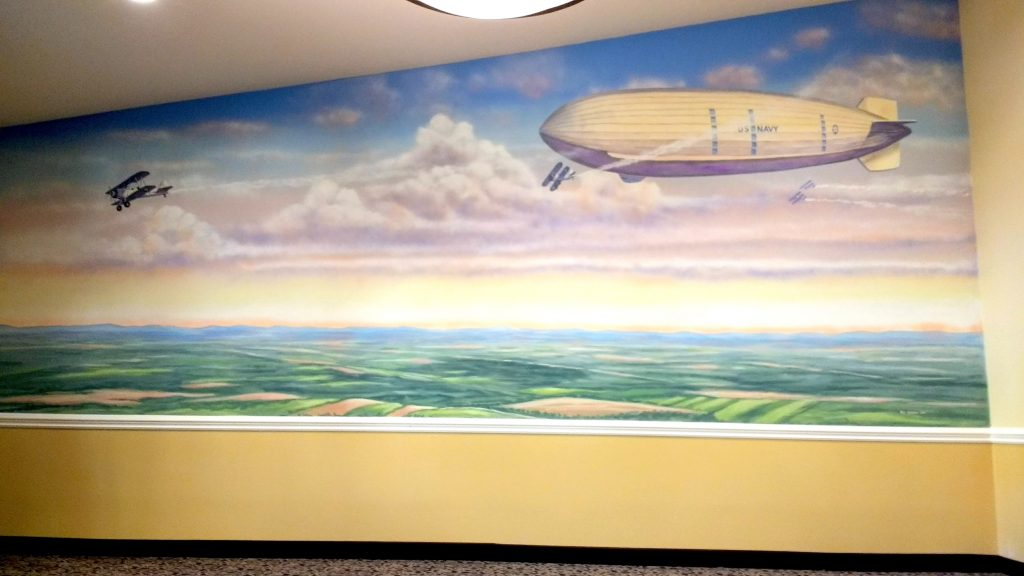 """Dirigible Mural"" U.S. Navy dirigible with biplanes over earth landscape. by San Diego Muralist Rik Erickson"