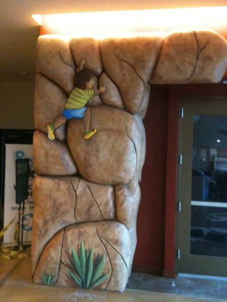 Rock Wall boy climbing sculpture San Diego