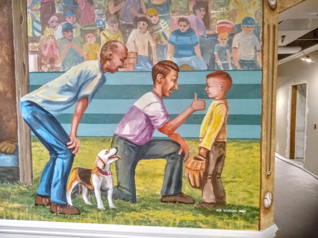 Coaching The Game mural painted for a memory care facility in Orange, California by San Diego muralist Rik Erickson