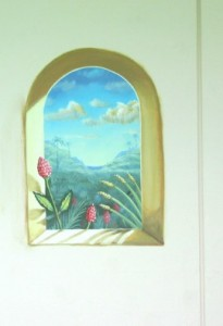 Ginger plant in arched window
