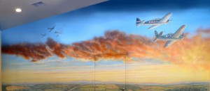 Historic mural with Corsair airplanes over land in sunset