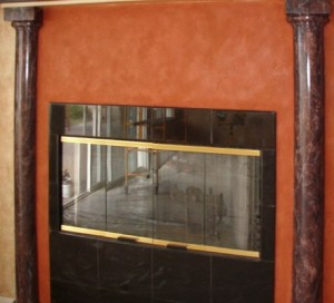 Red tinted Italian Plaster and faux black marble columns